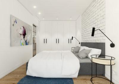 Sypialnia z białymi ścianami oraz szarym łóżkiem z białą pościelą i niebieskim dywanem pod łóżkiem