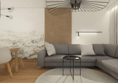 Salon z lamelami na ścianie i tapetą z górami i szarym narożnikiem