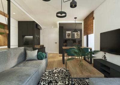 Strefa dzienna, salon z szarą sofą i drewnianym stolikiem kawowym