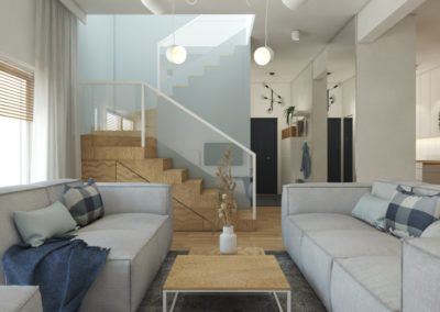 Salon z szarymi sofami i stolikiem kawowym z drewnianym blatem oraz drewnianymi schodami