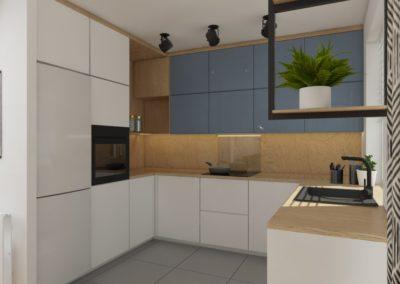 Kuchnia z białymi szafkami dolnymi oraz niebieskimi górnymi i drewnianym blatem