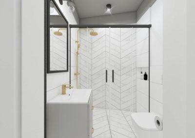 Łazienka z białymi jodełkowymi płytkami oraz złotymi i czarnymi elementami