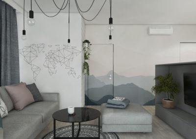 Salon z szarą sofą oraz wyspą na telewizor ze ścienną dekoracją