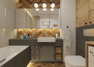 Łazienka z szarymi płytkami, zabudowaną wanną oraz jodełkową dekoracją na ścianie