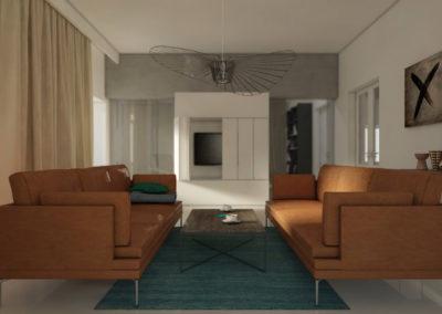 Salon z zielonym dywanem i karmelowymi kanapami
