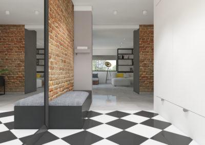 Hol z ceglaną ścianą i szarymi meblami zaprojektowany przez studio hex